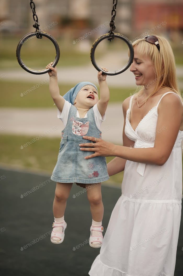 Mother with her daughter on playground
