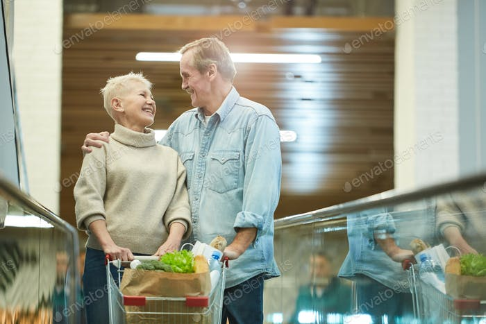 Smiling Senior Couple Shopping in Mall