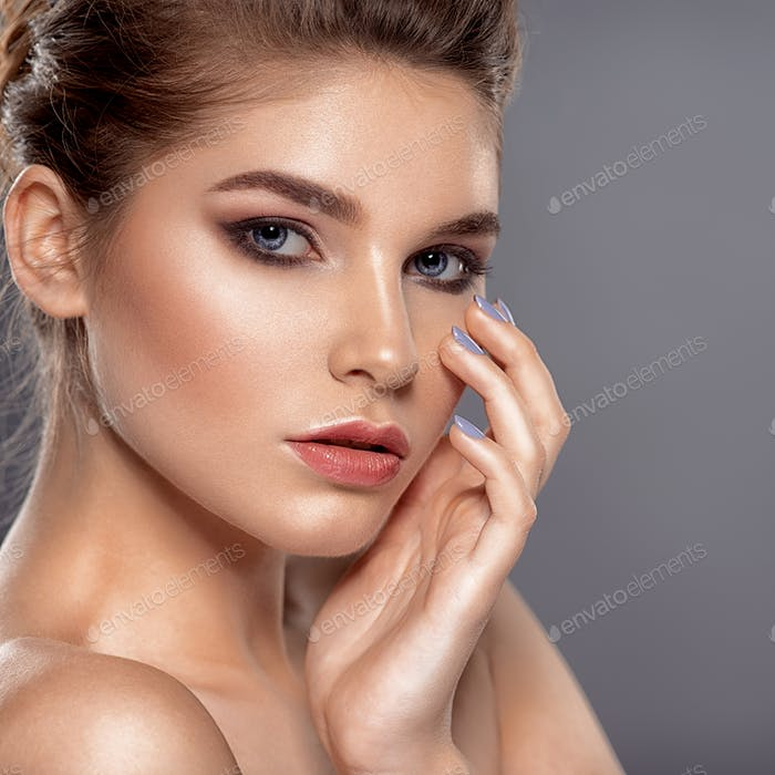 Beautiful face of young caucasian woman with health skin