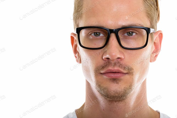 Close up of young handsome man wearing eyeglasses