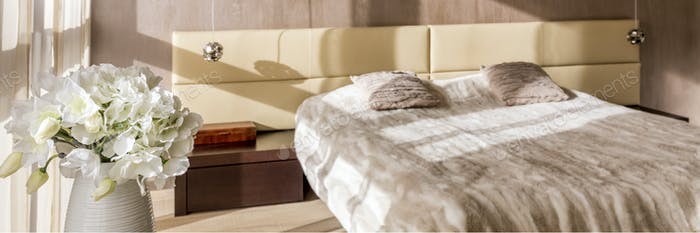Double bed with upholstered headboard