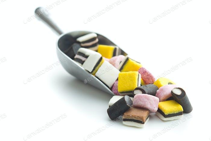 Mixed liquorice candies in scoop.