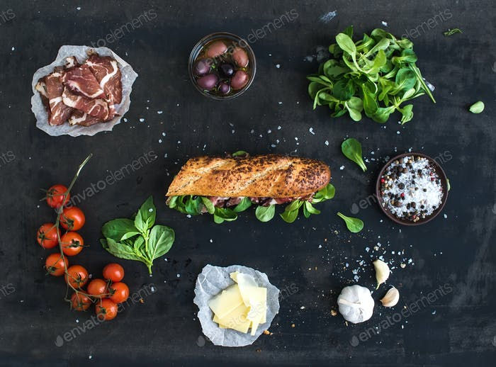 Ingredients for sandwich with smoked meat, baguette, basil, arugula, olives, cherry-tomatoes