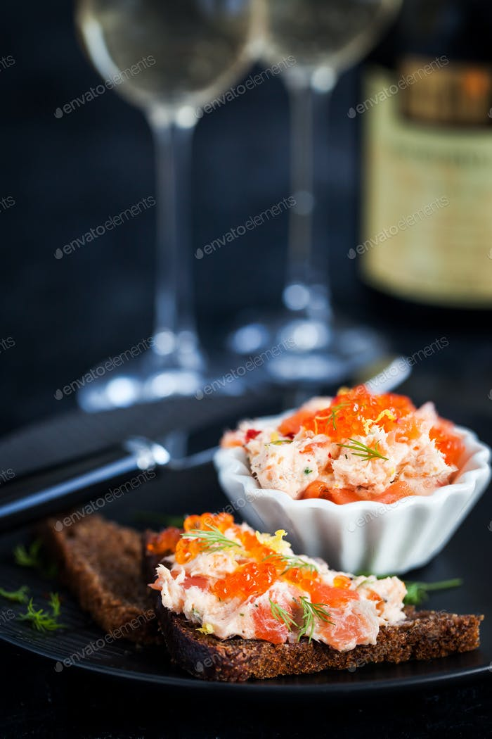 Salmon pate  with red caviar served with sliced bread