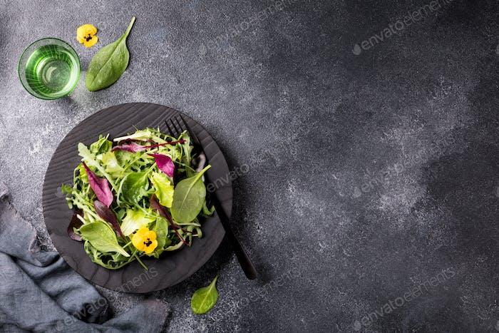 Salad from a fresh mix of leafy greens. Antiviral healthy food. Vitamins.