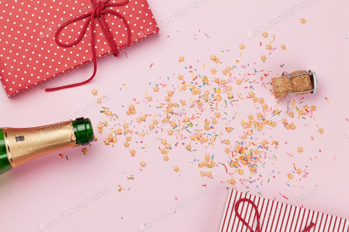 Champagne bottle and christmas gifts