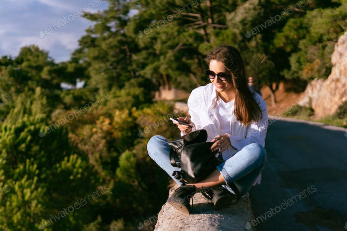 beautiful young woman resting on the nature