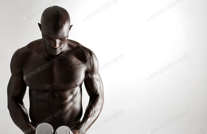 African male bodybuilder with dumbbells