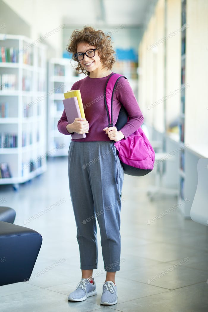 Modern student taking books in library