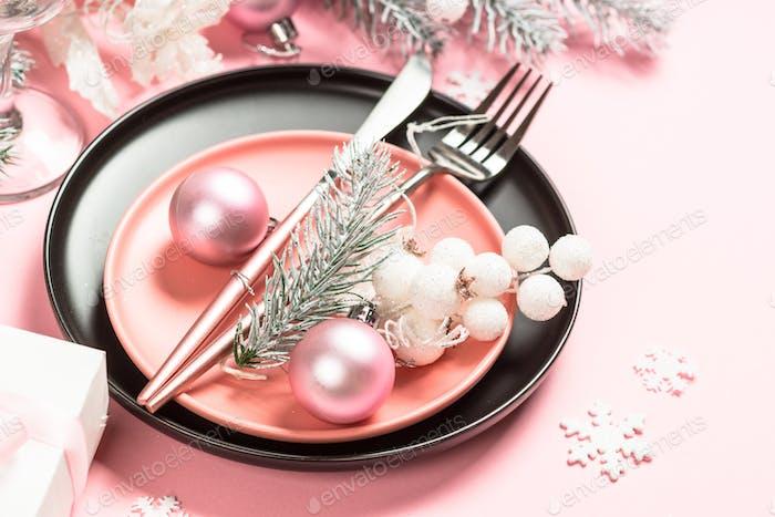 Christmas table setting on pink