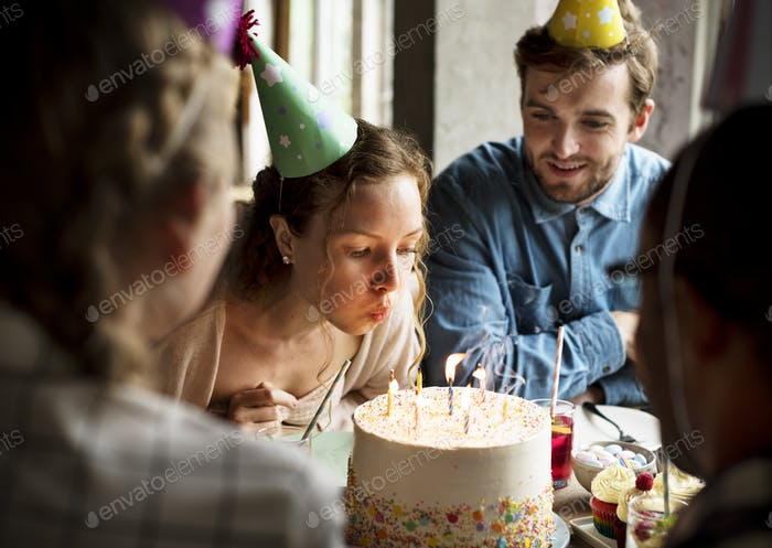 Woman Blowing Candles on Cake on Her Birthday Party Celebration