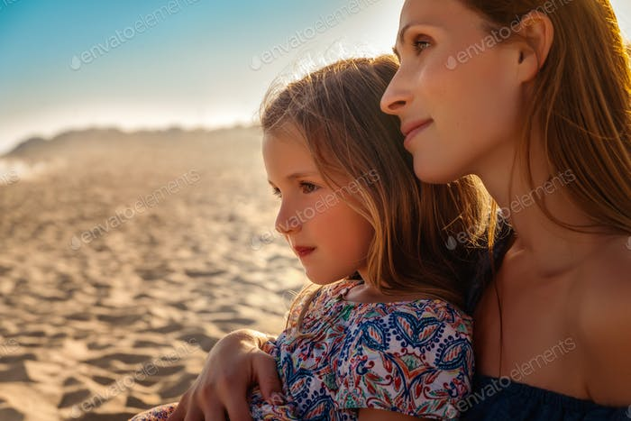 mother with girl watch sunset