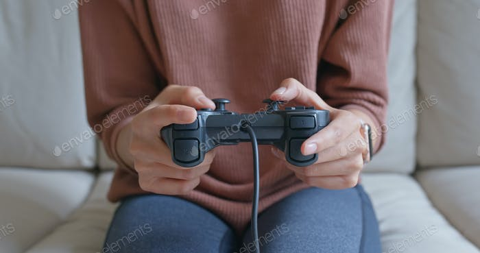 Woman play tv game at home