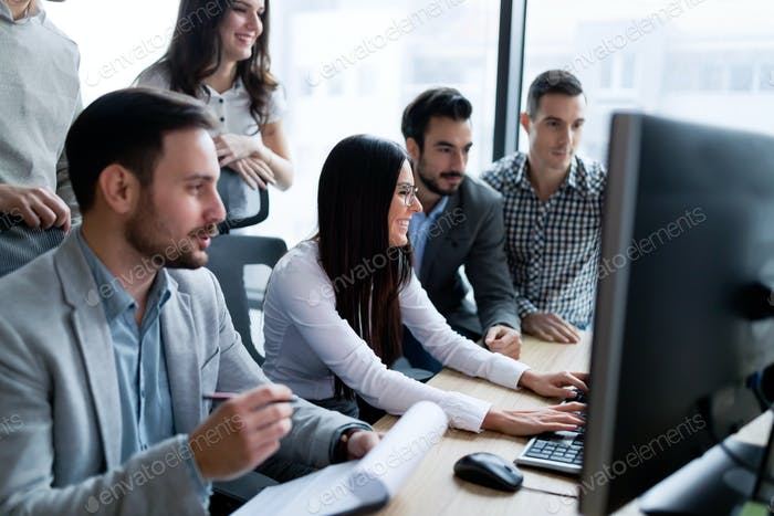 Young businesspeople working on computer in office