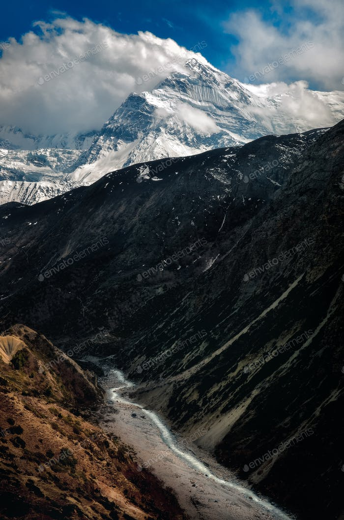 Landscape view of mountain valley, peaks and river in Himalayas, Nepal