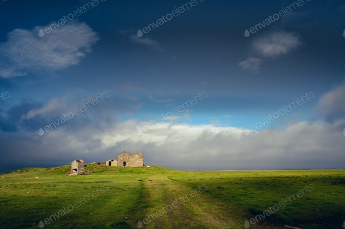 Landscape view of countryside with ruins of abandoned building, Iceland
