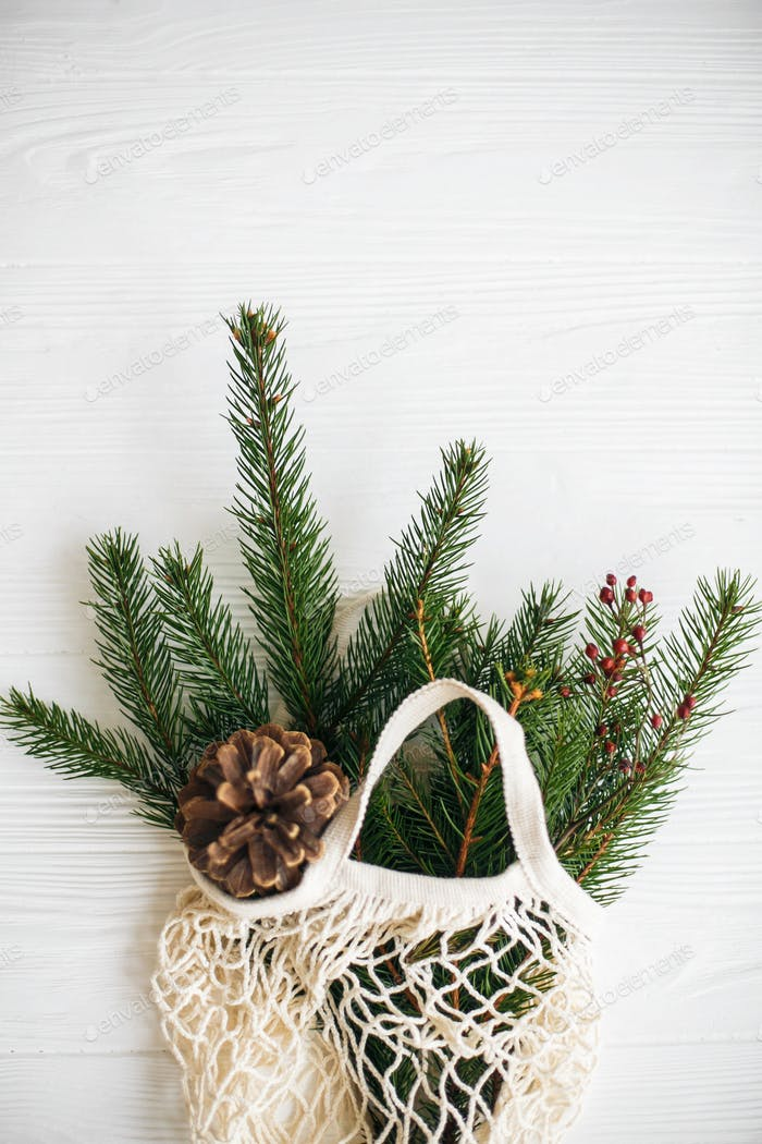 Net shopping bag with winter decorations, zero waste holidays