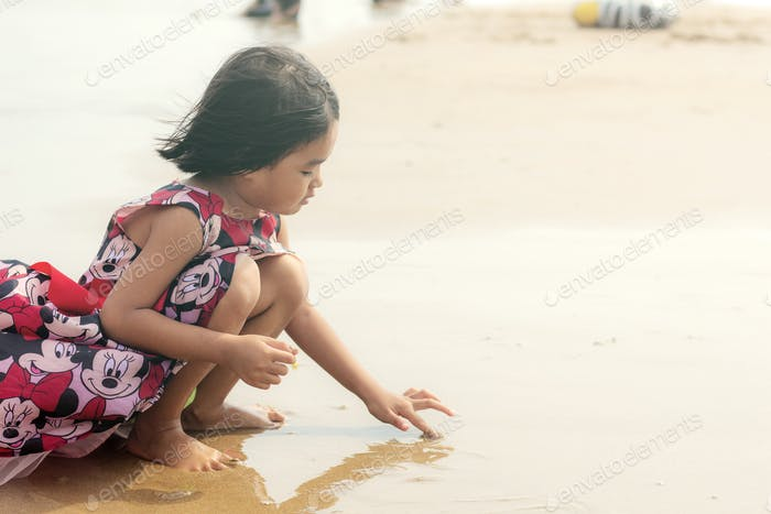 girls are playing on beach