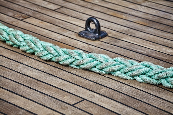 Rope on an old sailing ship wooden deck.