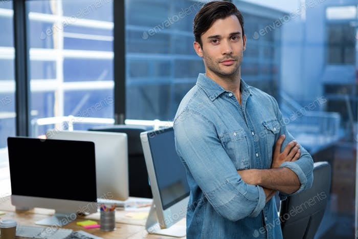 Confident man standing in office
