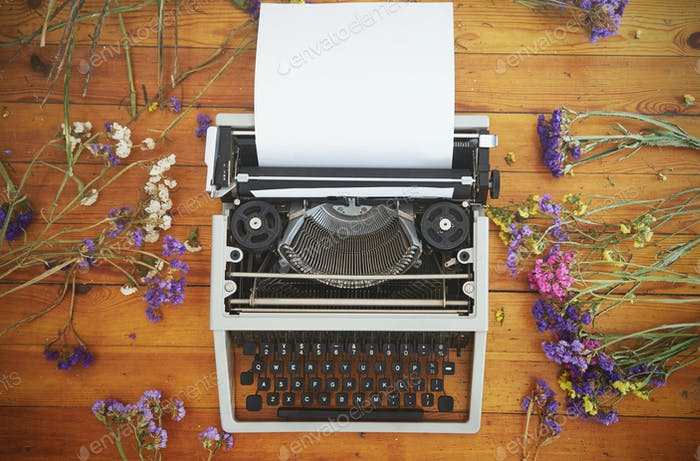 Vintage typewriter on  wooden background