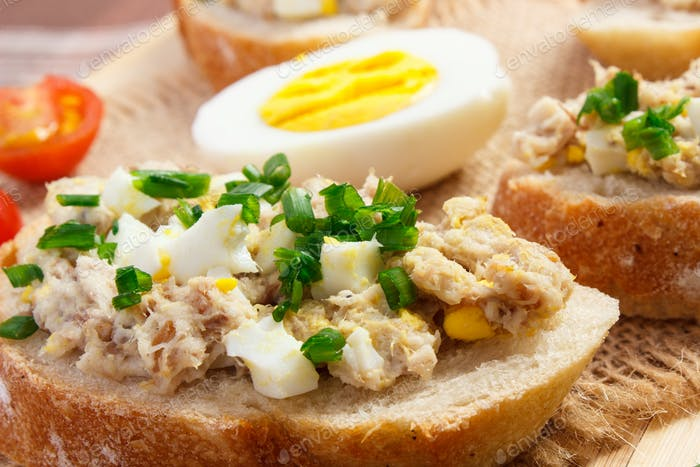 Crispy sandwiches or baguette with mackerel or tuna fish paste, healthy nutrition