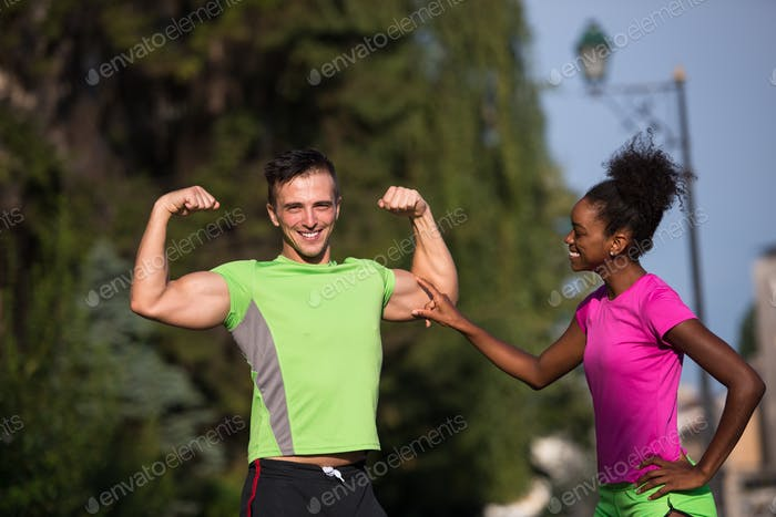 portrait of young multietnic jogging couple ready to run