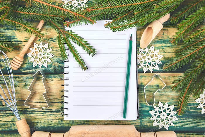 Christmas menu plan or recipe  on green rustic wooden background