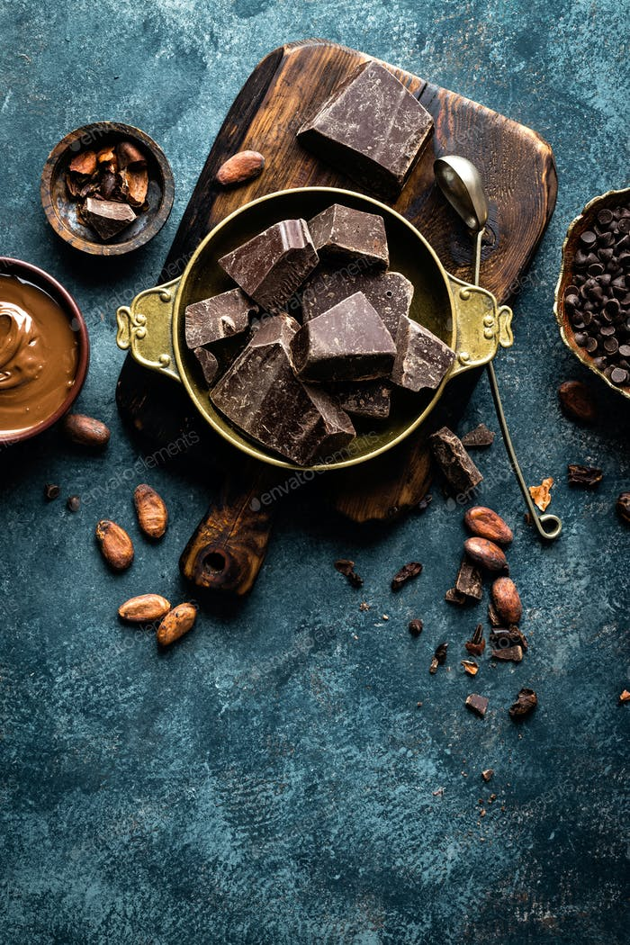 Thumbnail for Dark chocolate pieces crushed and cocoa beans. Chocolate background