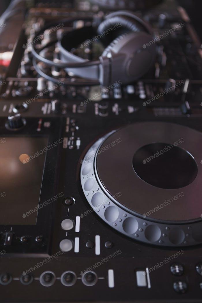 Sound mixer of DJ turntable at the nightclub