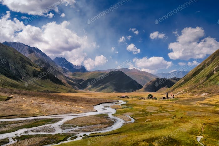 Landscape view of Caucasus mountains, river and stone houses and river