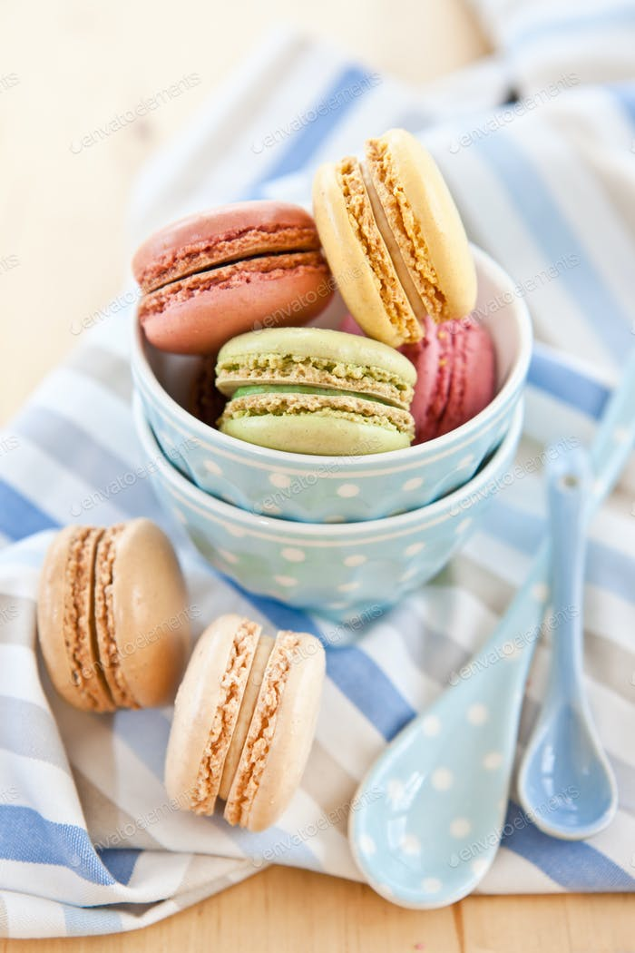 French macaroons in little blue cups
