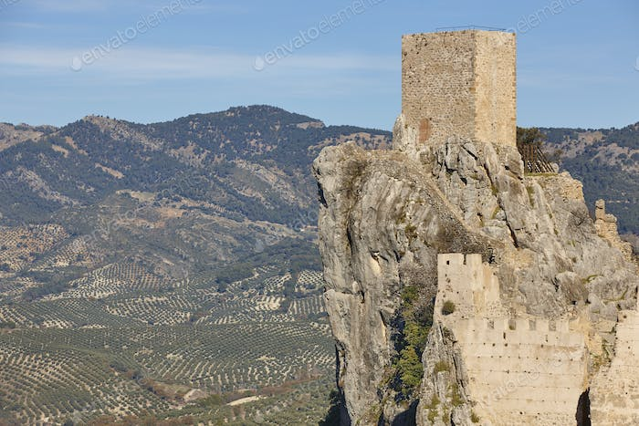 Ancient castle tower and olive fields in Jaen. Spain