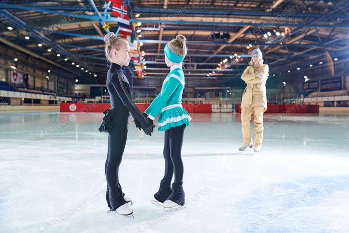 Two Cute Girls Figure Skating