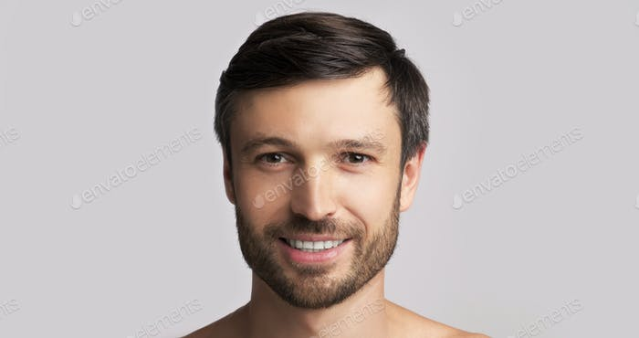 Smiling Middle-Aged Man Looking At Camera Over White Background, Panorama