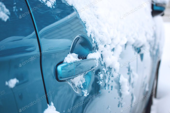 Car winter emergency. Weather-related vehicle emergencies. Automobile covered with snow in the