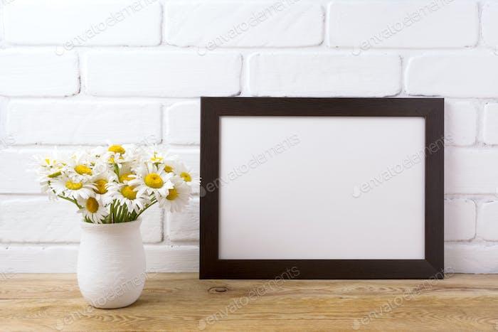 Black brown  landscape frame mockup with chamomile bouquet in ru