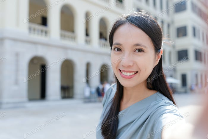 Woman hold with camera to take selfie