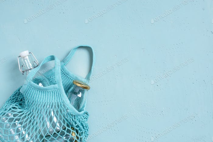 Blue Background with Mes Bag and Glass Dish