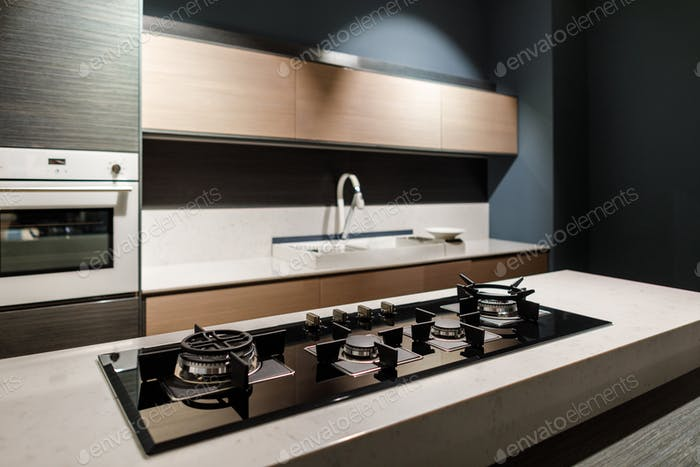 Interior of modern kitchen with metal stove