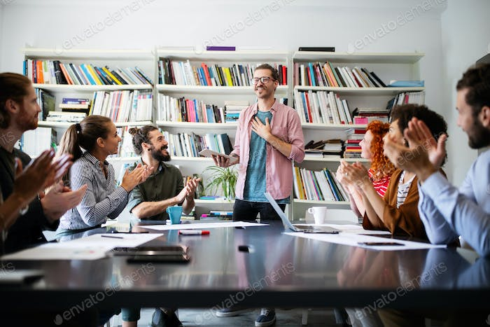 Group of people in a business meeting discussing ideas in office