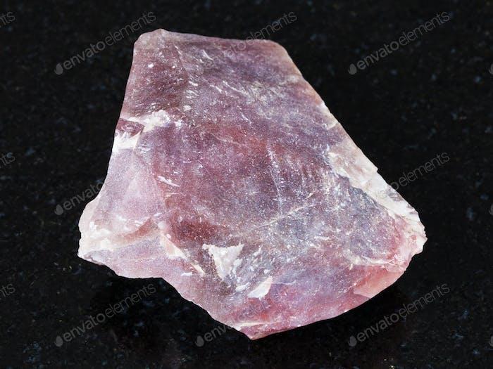 rough pink Flint stone (Chalcedony) on black