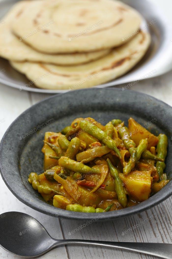 Sengri aloo ki sabzi, simmered radish pods & potatoes with spices, indian cuisine