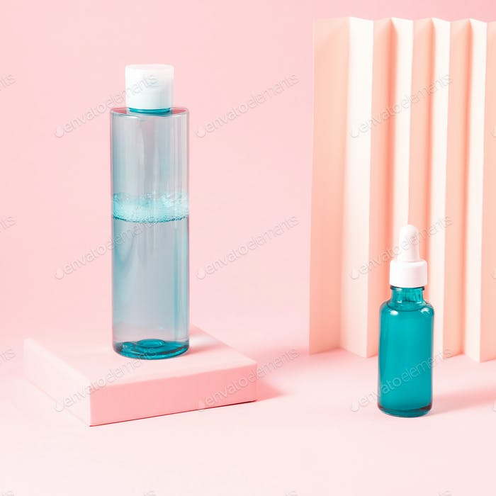 Hyaluronic acid serum and toner bottles on pink background