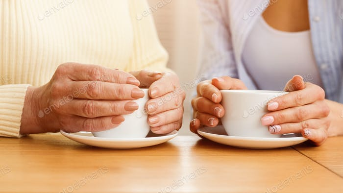 Coffee time. Mother and daughter drinking tea