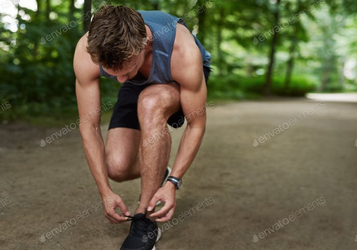 Jogger tying his shoe laces