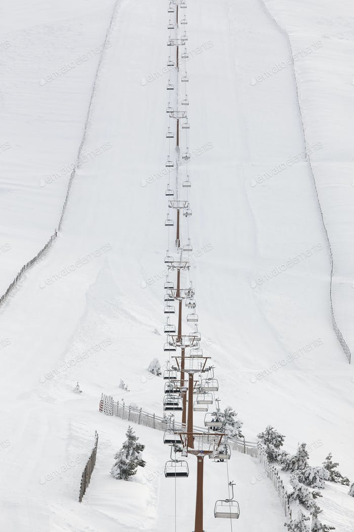 Ski lift and slope on a snow landscape. Winter sport