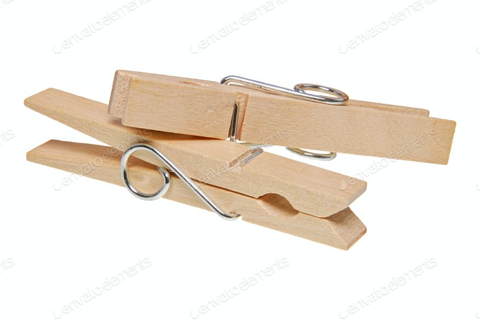 Wooden clothes pegs on a white background