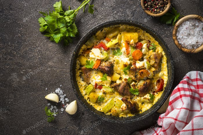 Frittata with meat and vegetables on dark background