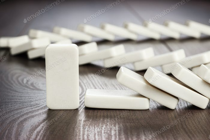 Domino Piece Standing Still Concept